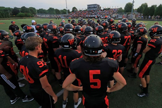 West De Pere players huddle before facing Shawano in a Bay Conference football game at West De Pere high school on  August 17 De Pere.