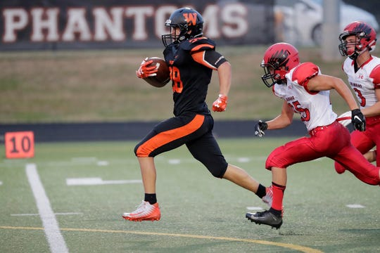 West De Pere's David Vanderlogt (28) rushes for a touchdown against Shawano in a Bay Conference football game at West De Pere high school on Friday, August 17, 2018 in De Pere, Wis.