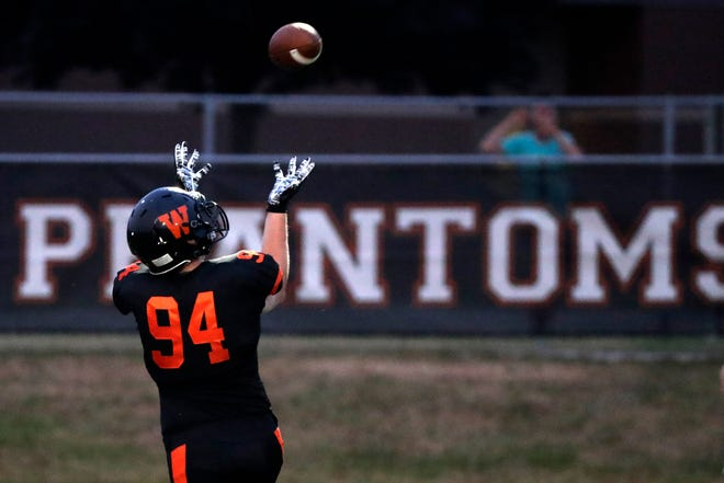 West De Pere's Billy Wyatt (94) catches a pass to score a touchdown against Shawano in a Bay Conference football game at West De Pere high school on Friday, August 17, 2018 in De Pere, Wis.