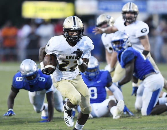 Greer running back Dre Williams (22) leaves the Byrnes defense to score one of his four touchdowns in the Yellow Jackets' 39-26 loss Friday night at Nixon Field.