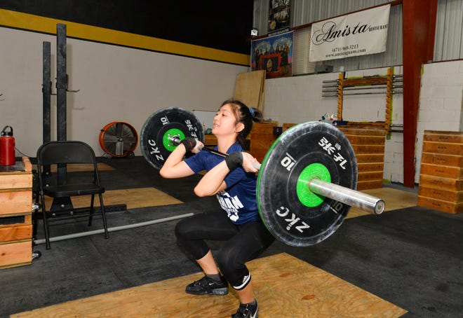 In this file photo from August 2018, Dayalani Calma performs a clean at Chomorri CrossFit in Tamuning.