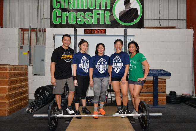 Ray Calma, left, and his wife, Loida Calma, right, are seen with their daughters at Chamorri CrossFit in Tamuning on Wednesday, Aug. 15, 2018. Their daughters,  from left; Dayalani Calma, 17; Dayanara Calma, 22 and Dayamaya Calma, 16.