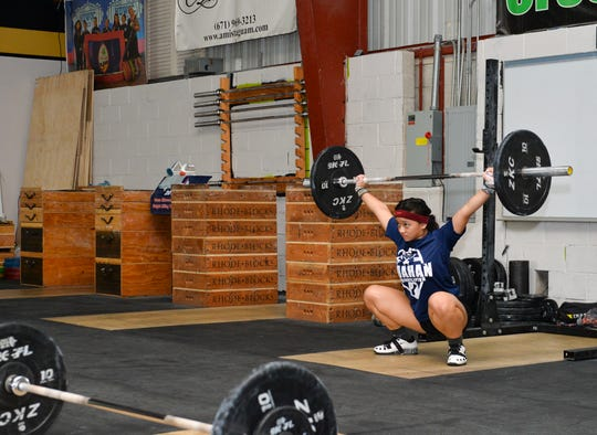 Dayamaya Calma performs a snatch at Chomorri CrossFit in Tamuning on Wednesday Aug. 15, 2018.