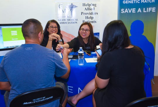 Dr. Shieh Clinic nurses, Grace Navasca, facing right, and Carina Valeria, assist a couple in registering during a bone marrow drive at the Agana Shopping Center on Saturday, Aug. 18, 2018. The drive, hosted by the Guam Medical Association, was held to search for compatible donors to benefit Imani Malanche.