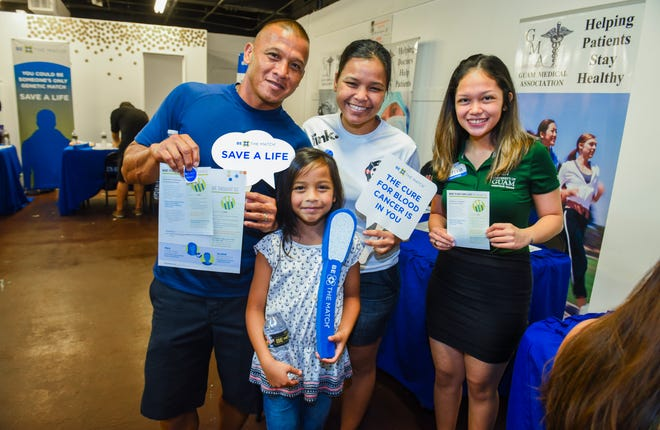 Joe Sablan, left, and his family smile for a photo after registering at a bone marrow drive at the Agana Shopping Center on Saturday, Aug. 18, 2018. The drive, hosted by the Guam Medical Association, was held to search for donors to benefit Imani Malanche.