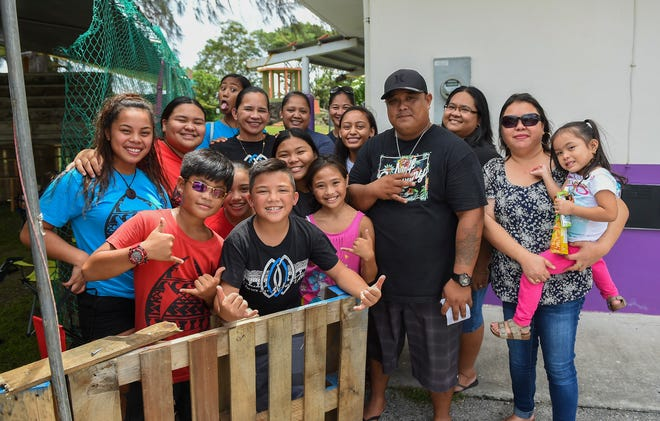 "The ""Break the bottle""  game crew with their parents during the second annual Santa Rosa Fiesta Carnival in Agat on Aug. 18, 2018."