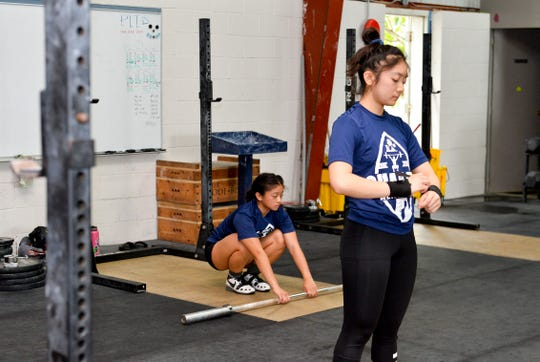Sisters Dayamaya and Dayalani Calma prepare themselves to work out at Chamorri CrossFit in Tamuning on Wednesday Aug. 15, 2018.