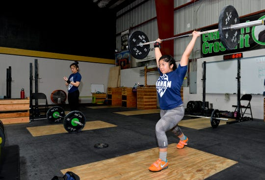 Dayanara Calma performs a clean and jerk at Chomorri CrossFit in Tamuning on Wednesday Aug. 15, 2018.