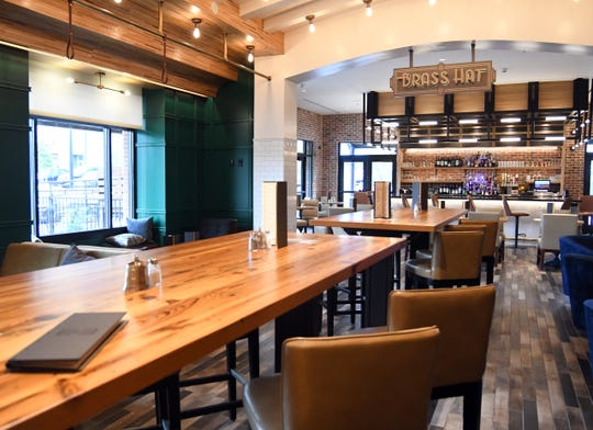 Hotel Indigo's Brass Hat bar has a variety of local food and beverage choices for guests.