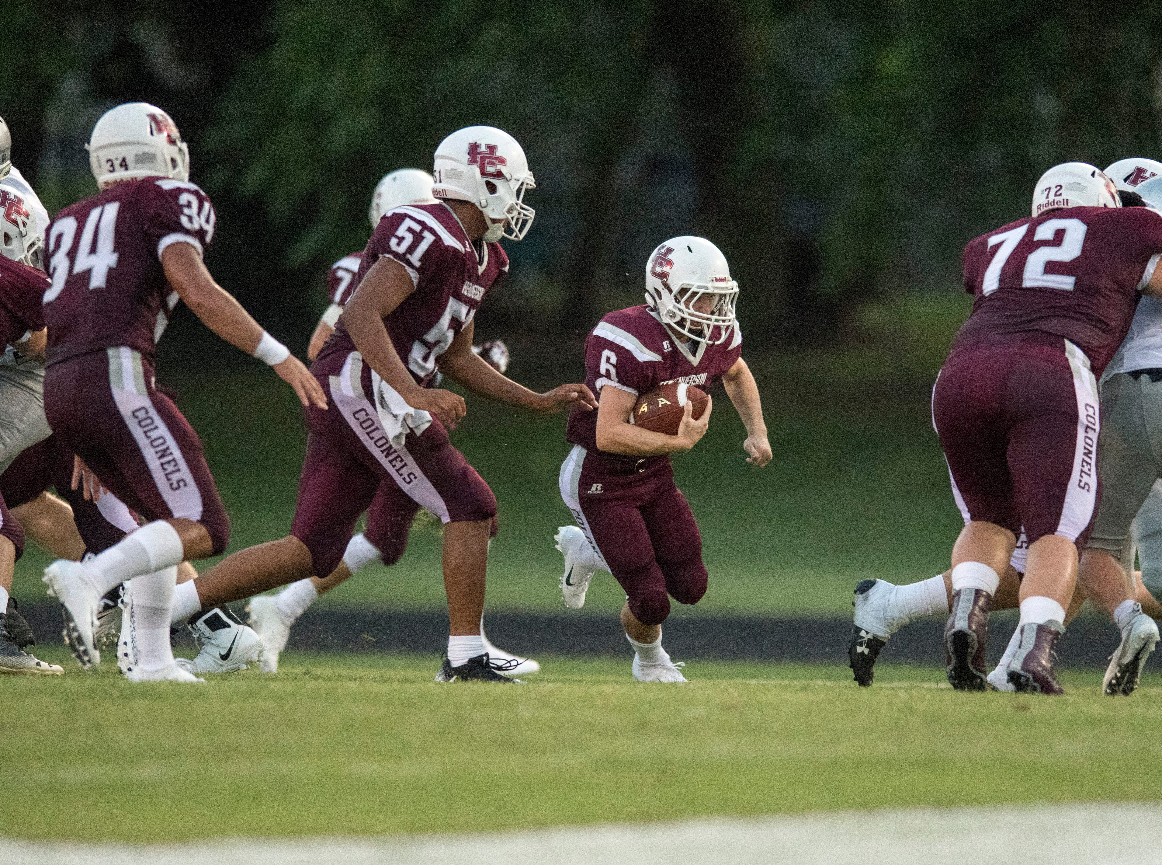 HendersonÕs Logan Green (6)  looks for an open lane during the Reitz vs Henderson County game at Colonel Stadium Friday, August 17, 2018. The Panthers defeated the Colonels 41-35 in the season opening game.