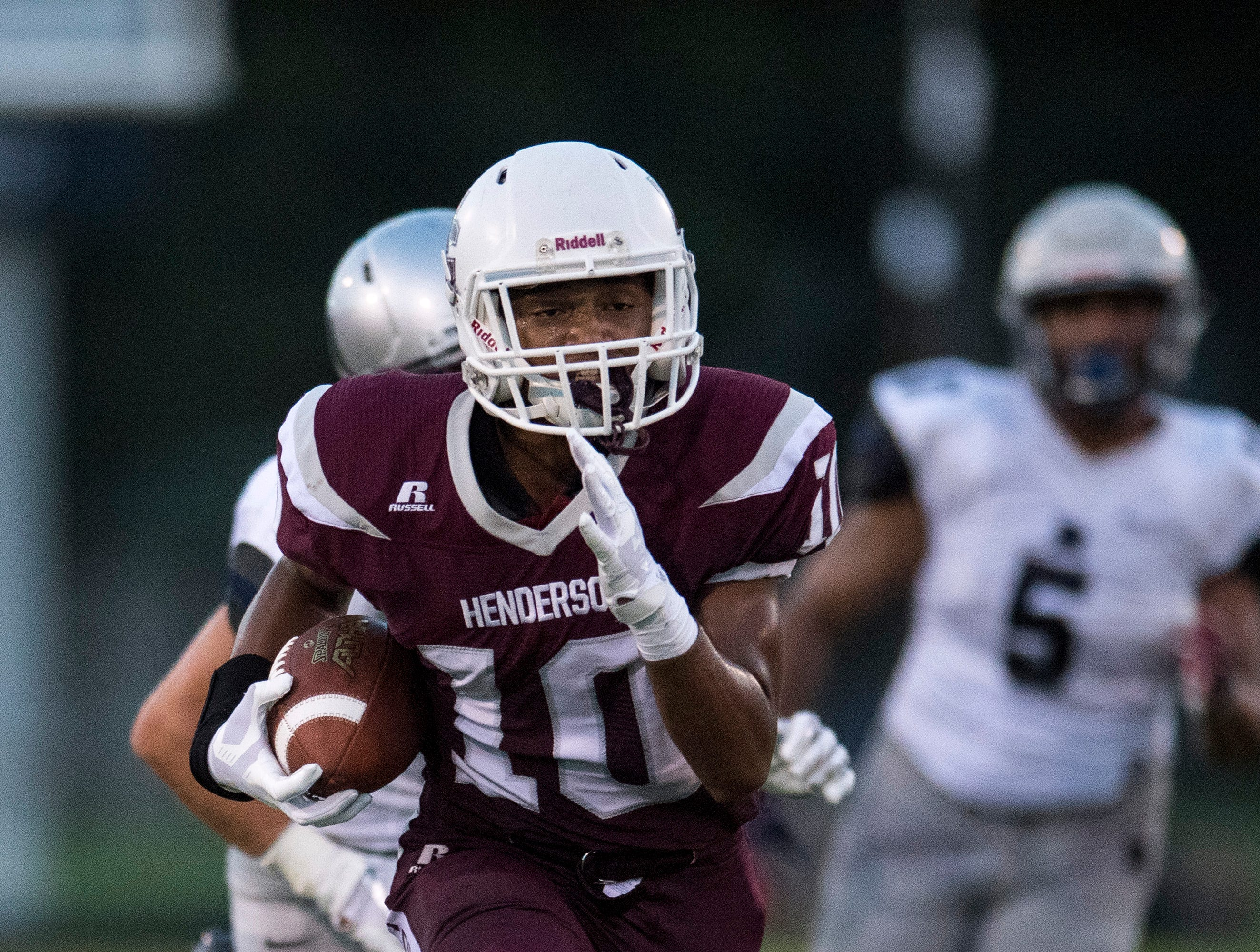 Henderson's Daymian Dixon (10)  runs the ball during the Reitz vs Henderson County game at Colonel Stadium Friday, August 17, 2018. The Panthers defeated the Colonels 41-35 in the season opening game.