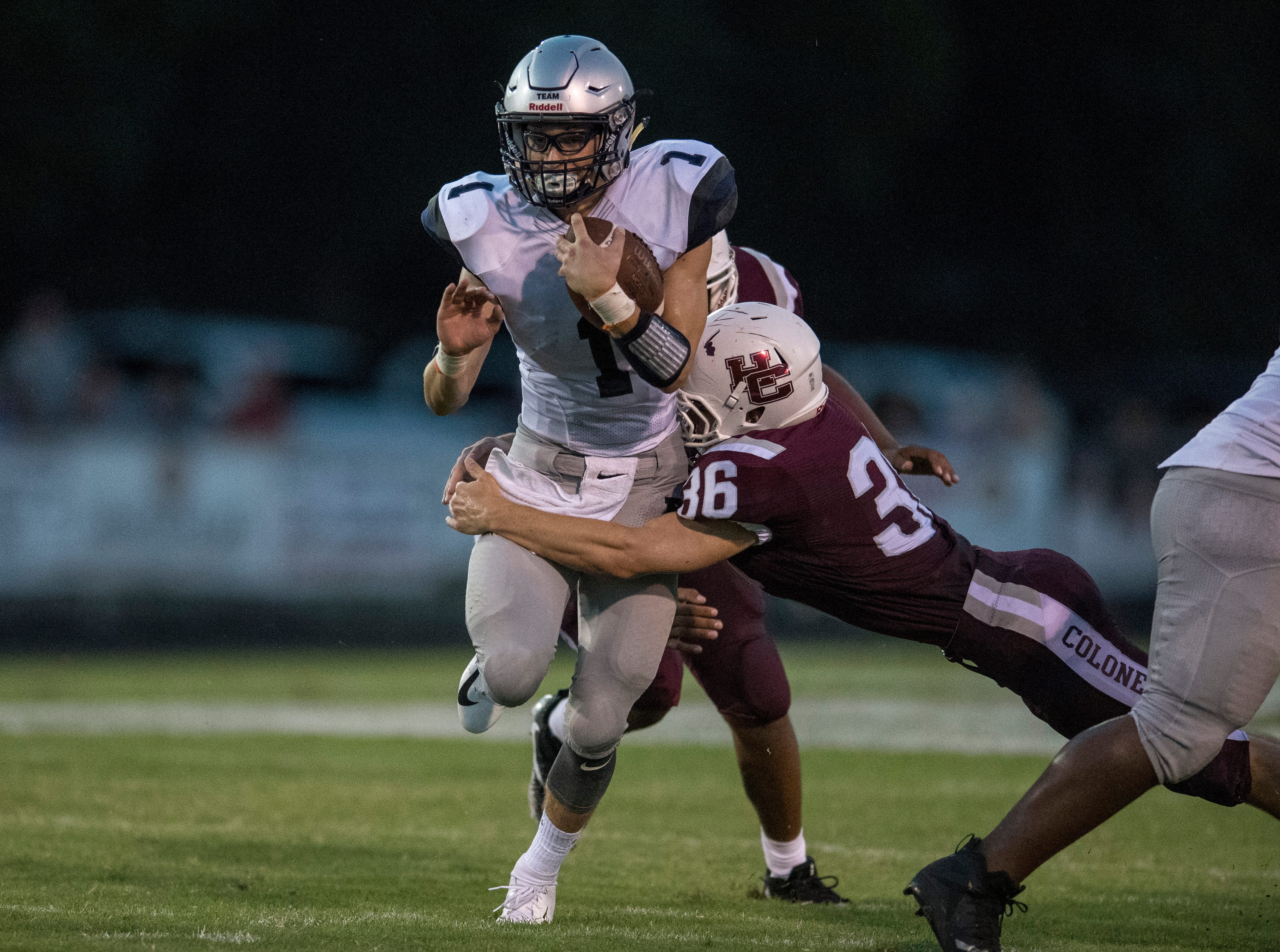 HendersonÕs Nakota Taylor (36)  goes in for a tackle against the Reitz Panthers ReitzÕs Quarterback Eli Wiethop (1) during the Reitz vs Henderson County game at Colonel Stadium Friday, August 17, 2018. The Panthers defeated the Colonels 41-35 in the season opening game.