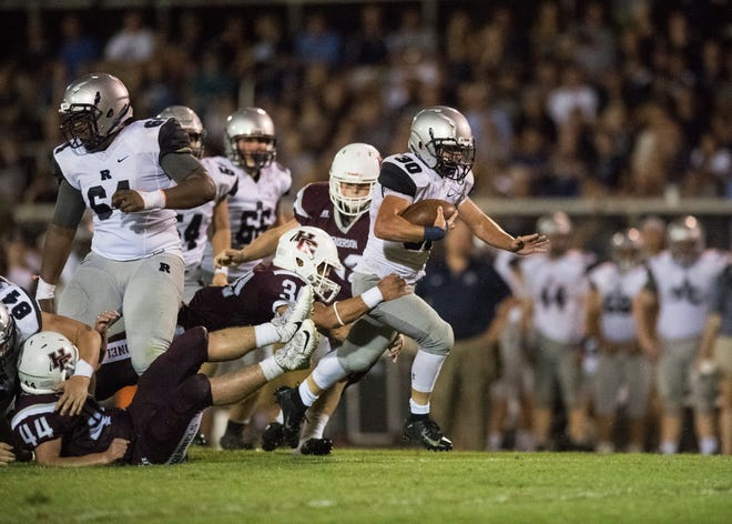 Reitz's running game led the Panthers to a 41-35 win last season on the West Side of Evansville. Alex Mitchell, shown here running the ball in last season's matchup, is back for Reitz this season. The two teams play in Henderson on Friday night.