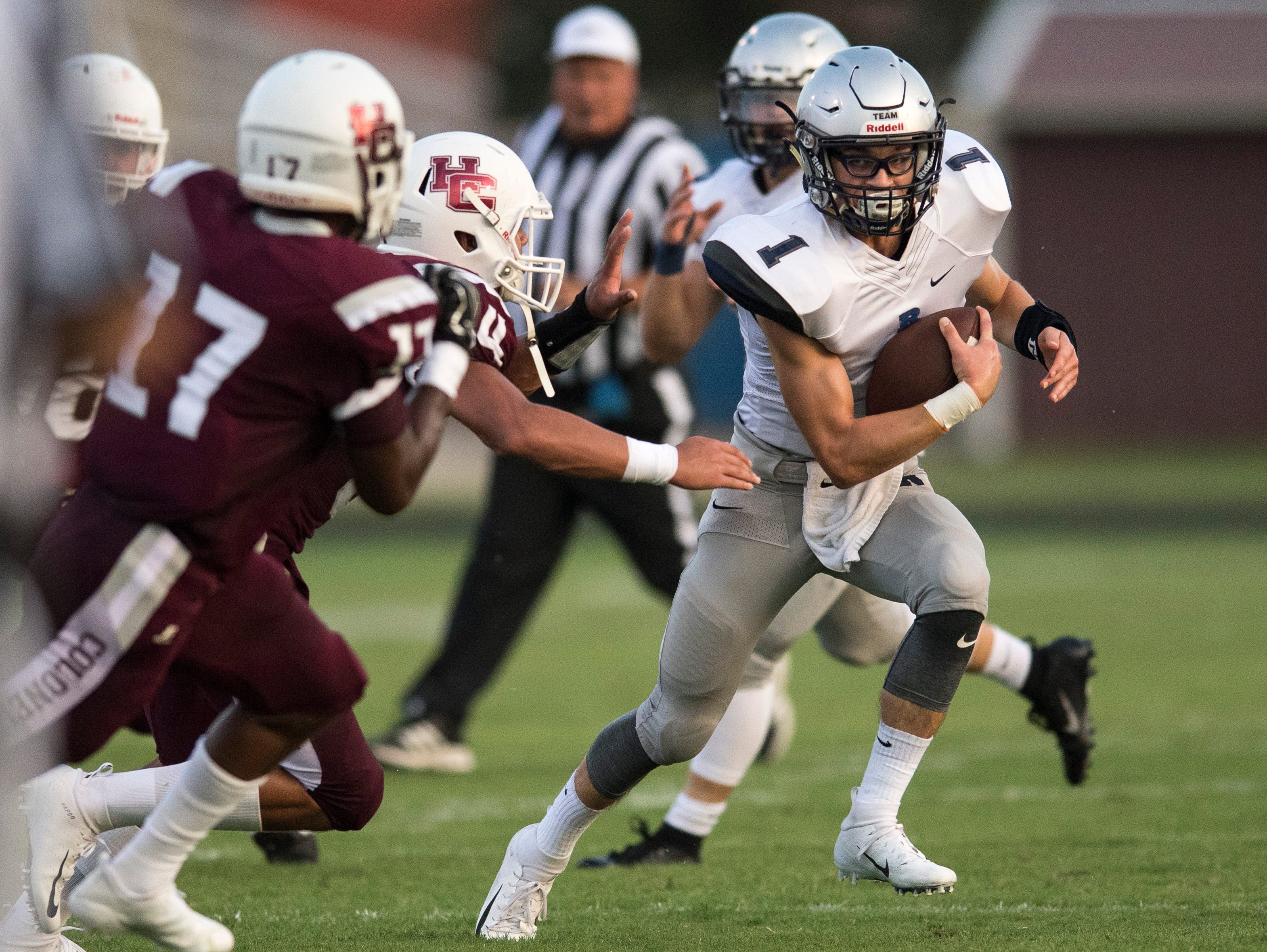 Reitz's Quarterback Eli Wiethop (1) attempts to run through Henderson County defense during the Reitz vs Henderson County football game Colonels Stadium Friday, August 17, 2018.  The Panthers defeated the Colonels 41-35 in the season opening game.