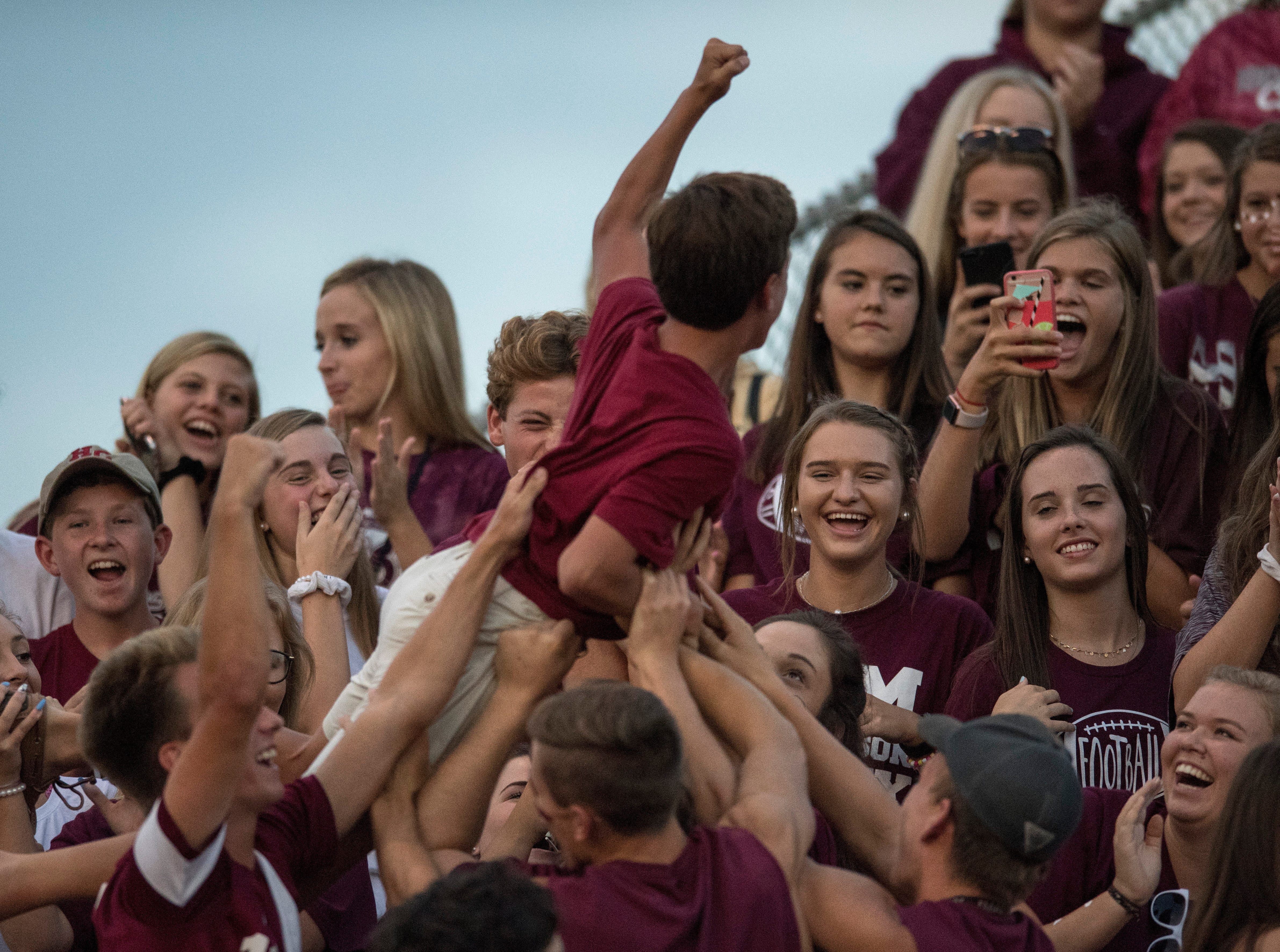 Fans take photos while cheering on the Henderson Colonels during the season opener against the Reitz Panthers on Friday, August 17, 2018. The Panthers defeated the Colonels 41-35 in the season opening game.
