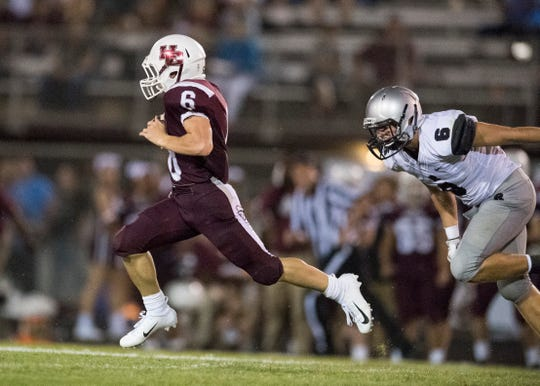 HendersonÕs Logan Green (6)  runs pass Reitz's Hunter Fox (6) during the Reitz vs Henderson County game at Colonel Stadium Friday, August 17, 2018. The Panthers defeated the Colonels 41-35 in the season opening game.