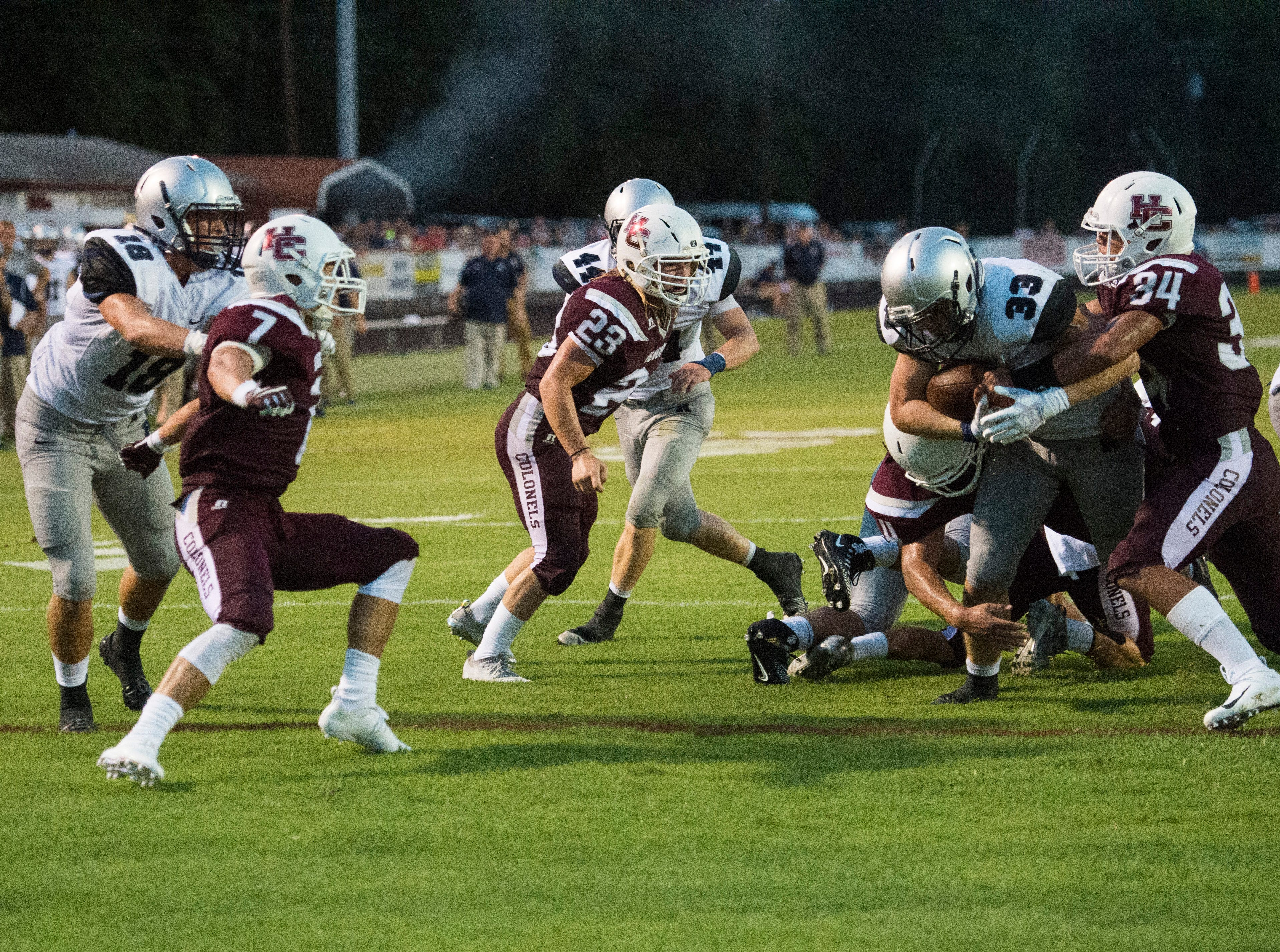 Henderson's Isaiah Fallen (34)  takes down the Panthers Reitz's Carter Schnarr (33) during the Reitz vs Henderson County game at Colonel Stadium Friday, August 17, 2018. The Panthers defeated the Colonels 41-35 in the season opening game.