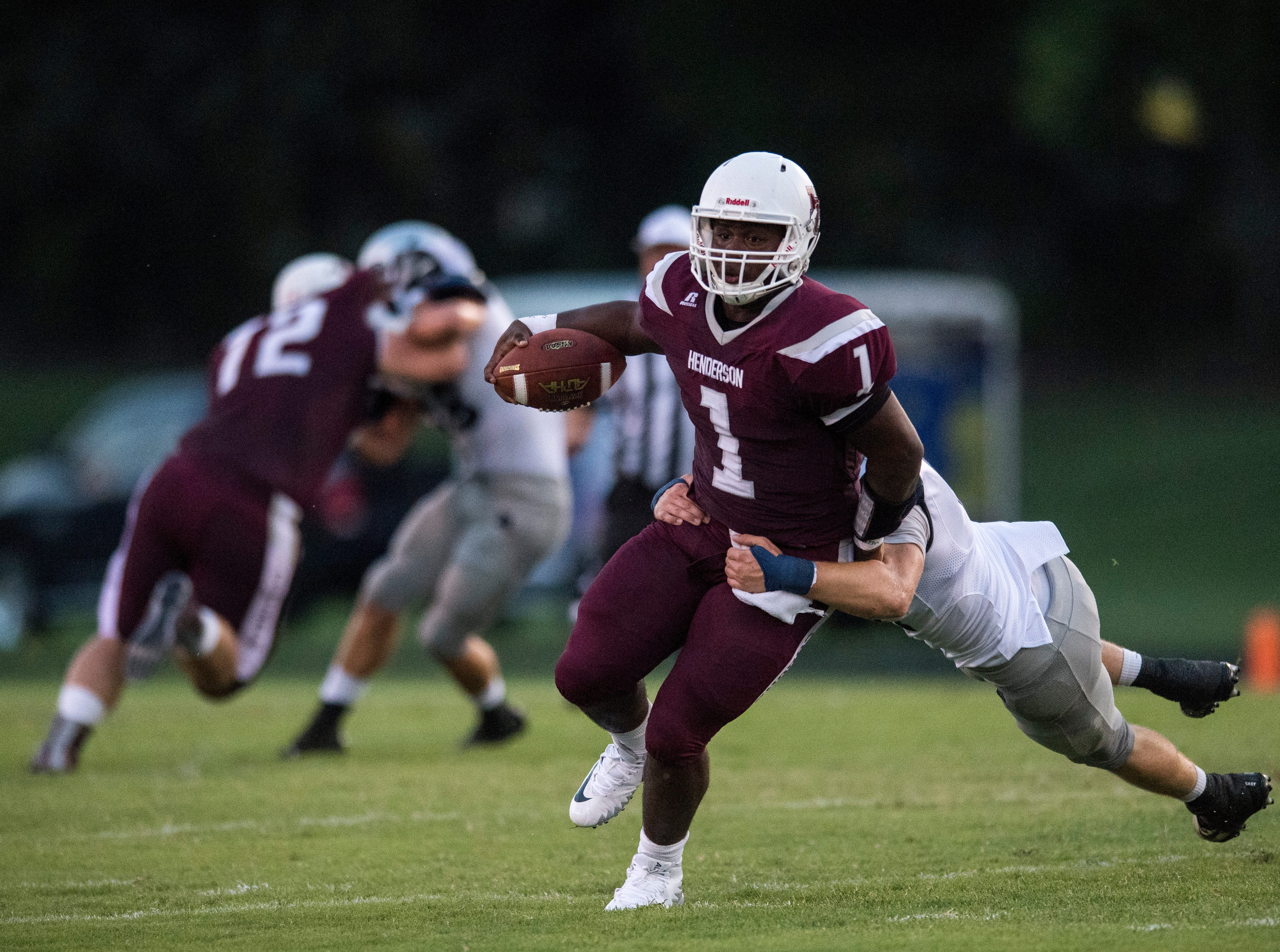 Reitz's Adam Euler (44) tackles HendersonÕs Quarterback Skip Patterson (1) during the Reitz vs Henderson County game at Colonel Stadium Friday, August 17, 2018. The Panthers defeated the Colonels 41-35 in the season opening game.