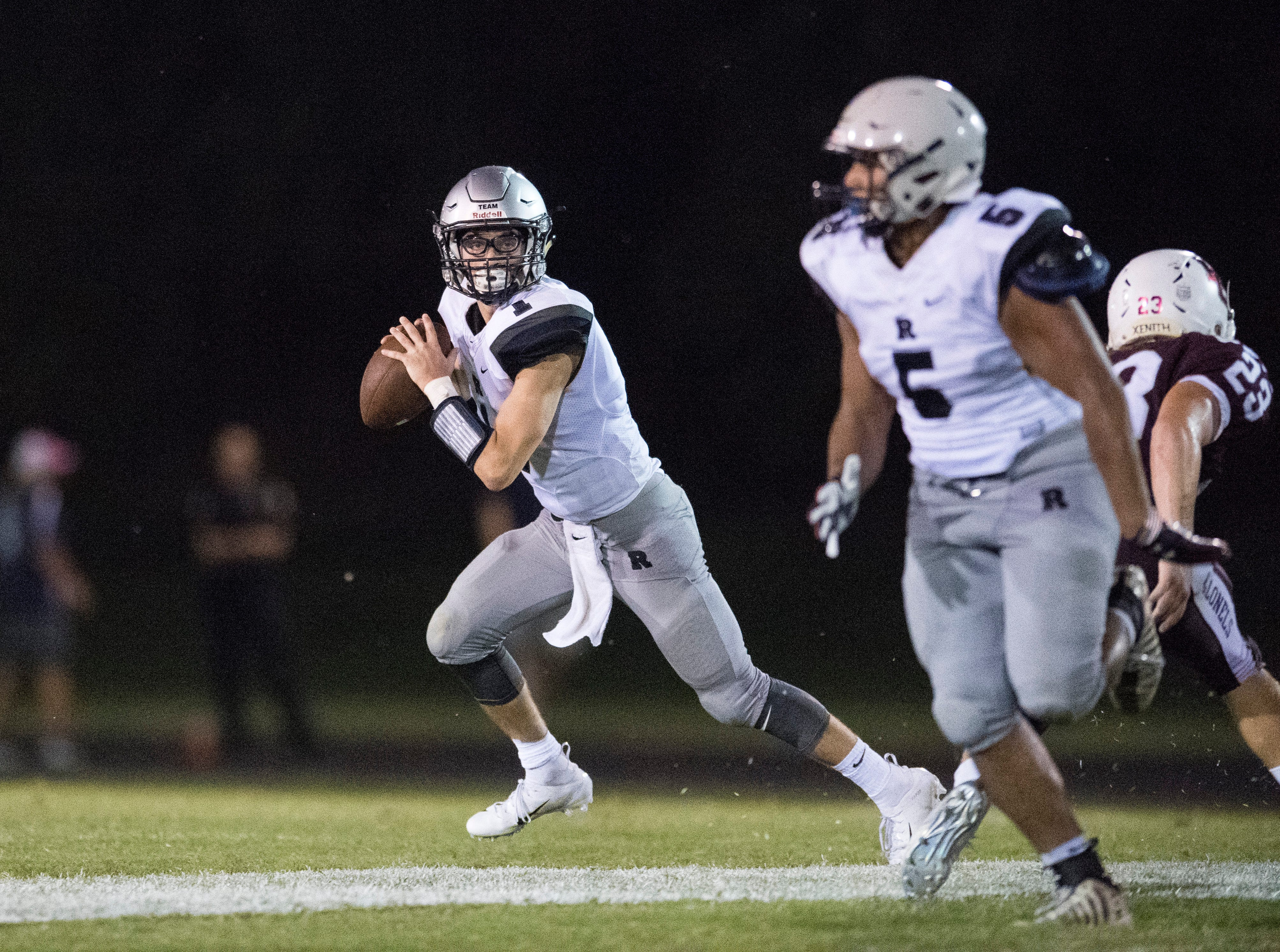 Reitz's Quarterback Eli Wiethop (1) looks for an open man during the Reitz vs Henderson County game at Colonel Stadium Friday, August 17, 2018. The Panthers defeated the Colonels 41-35 in the season opening game.