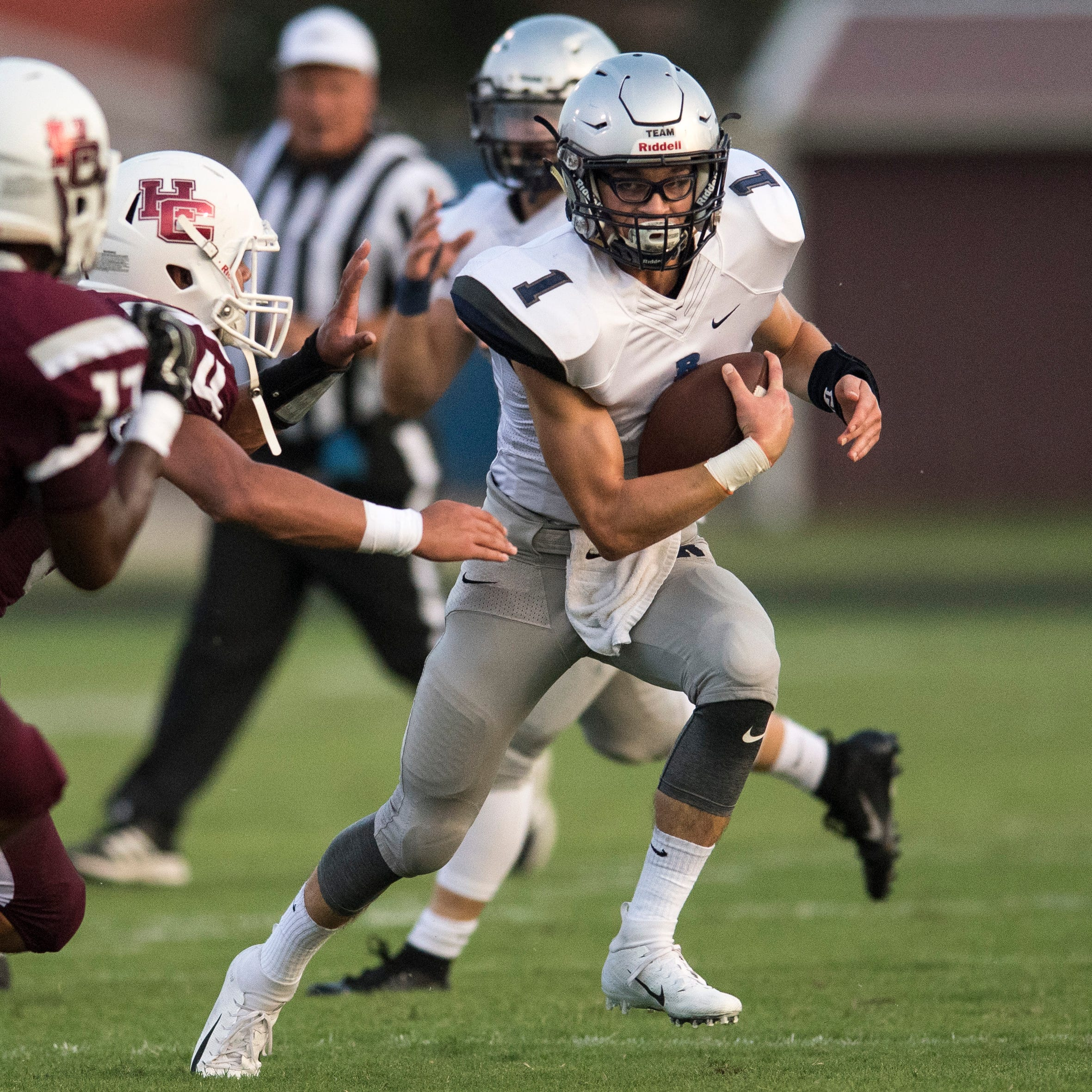 Reitz's Quarterback Eli Wiethop (1) attempts to run through Henderson County defense during the Reitz vs Henderson County football game Colonels Stadium Friday, August 17, 2018.