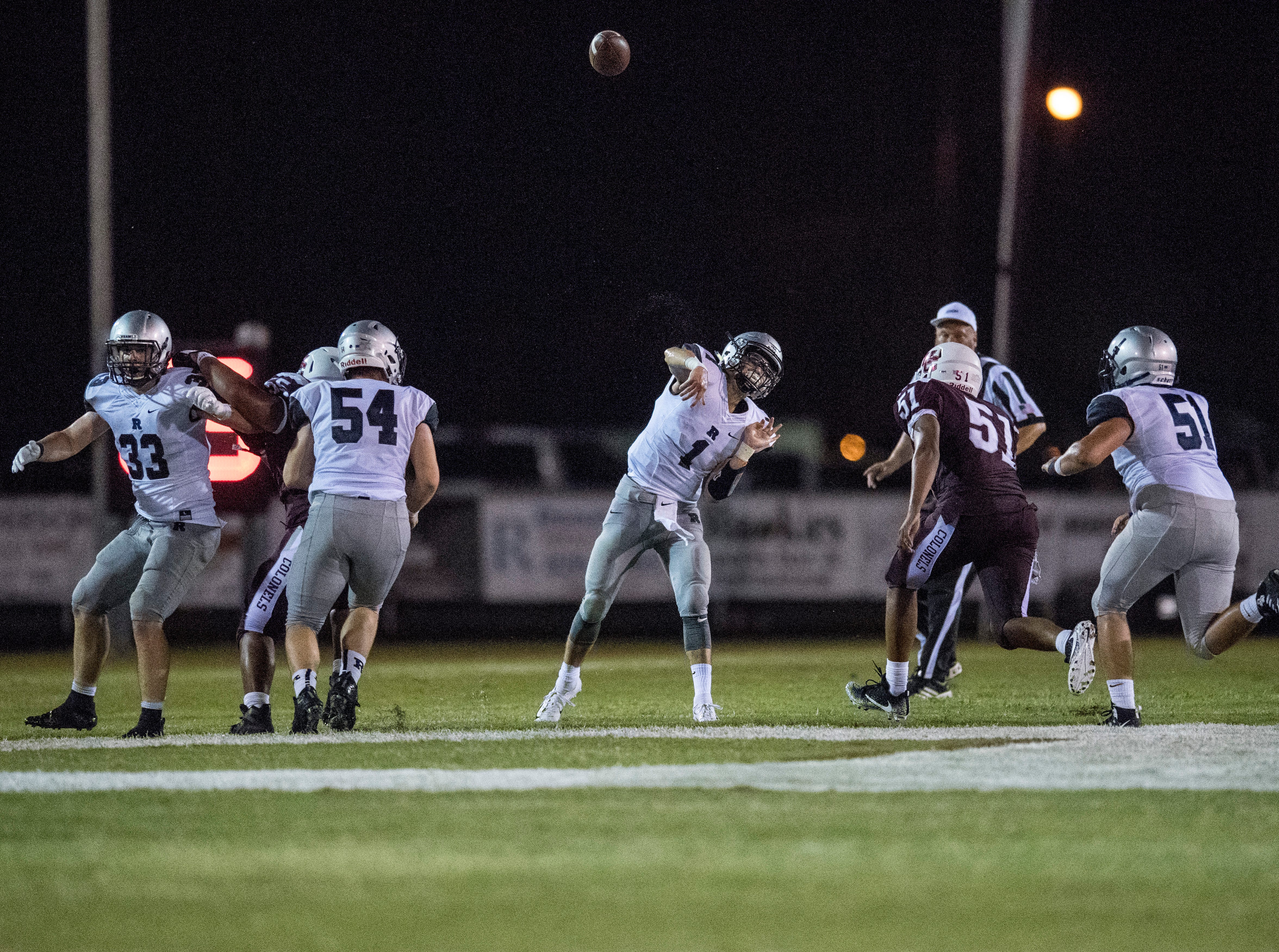 ReitzÕs Quarterback Eli Wiethop (1) throws a long pass during the Reitz vs Henderson County game at Colonel Stadium Friday, August 17, 2018. The Panthers defeated the Colonels 41-35 in the season opening game.