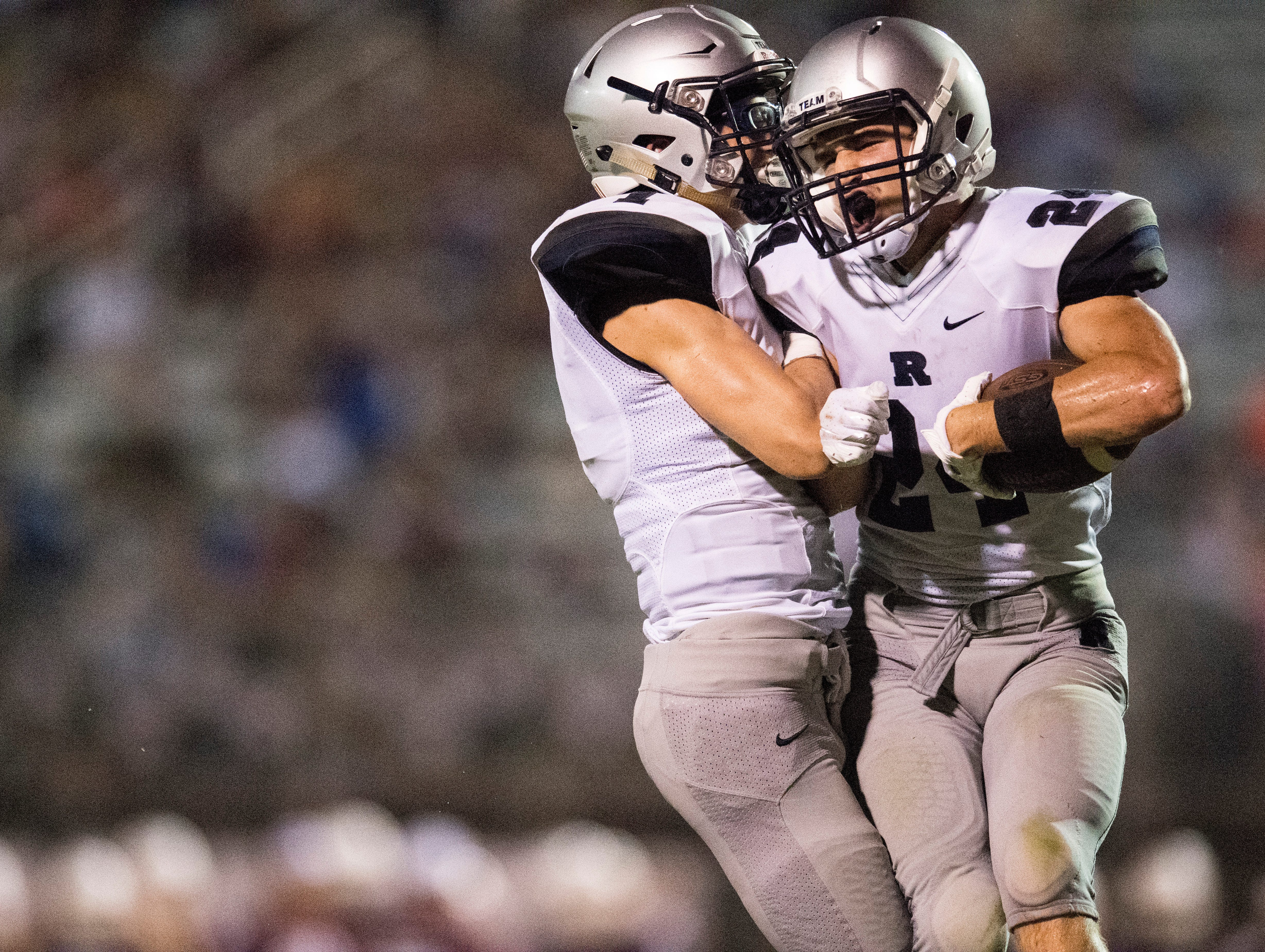 Reitz's Quarterback Eli Wiethop (1) celebrates with Reitz's Andrew Word (24) after a touchdown in the third quarter of Reitz vs Henderson County game at Colonel Stadium Friday, August 17, 2018. The Panthers defeated the Colonels 41-35 in the season opening game.