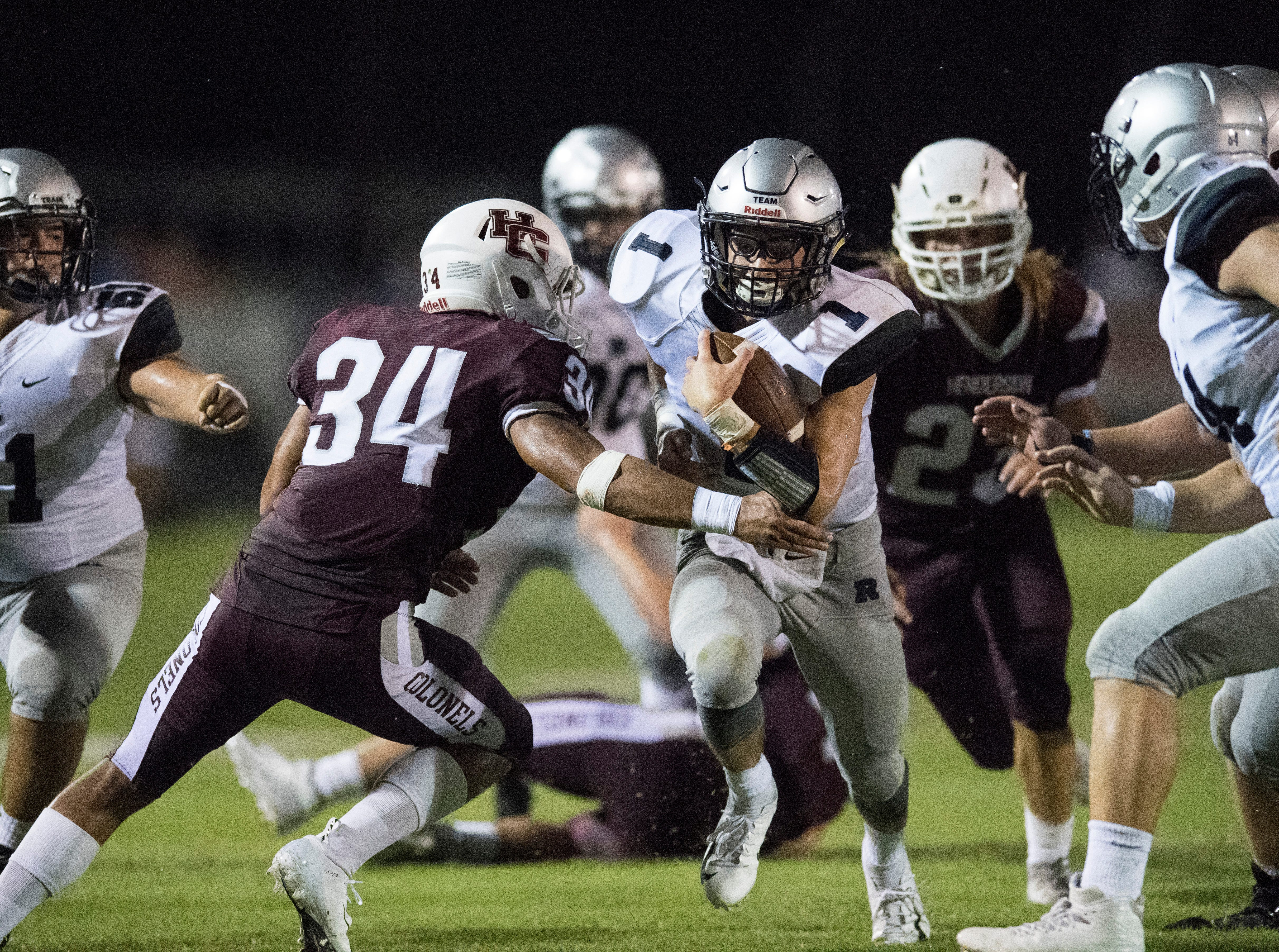 Reitz's Quarterback Eli Wiethop (1)  runs the ball through the Henderson Colonels defensive line during the Reitz vs Henderson County game at Colonel Stadium Friday, August 17, 2018. The Panthers defeated the Colonels 41-35 in the season opening game.