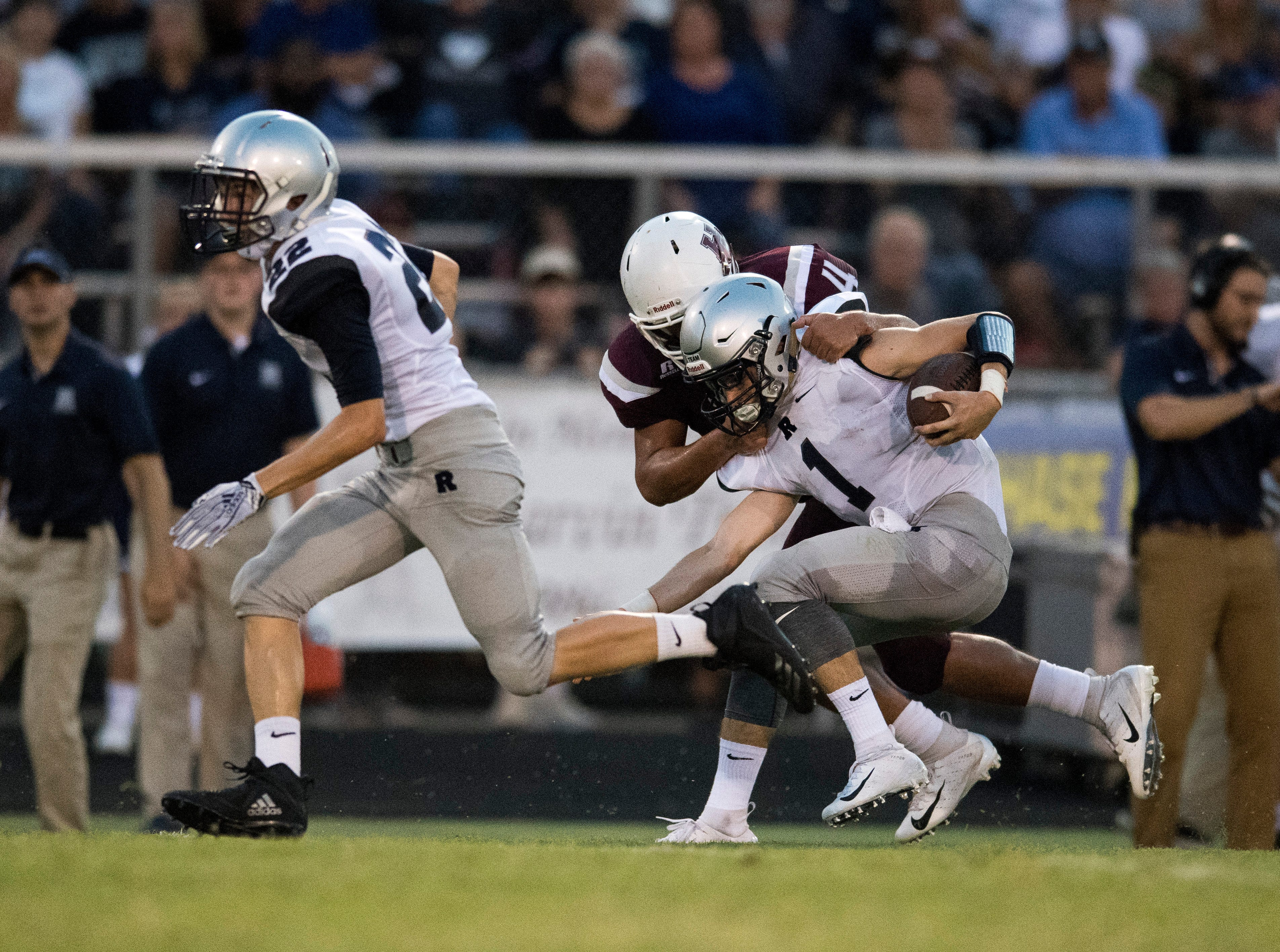 ReitzÕs Quarterback Eli Wiethop (1)  is tackled by HendersonÕs Layton Fletcher (4)  during the Reitz vs Henderson County game at Colonel Stadium Friday, August 17, 2018. The Panthers defeated the Colonels 41-35 in the season opening game.