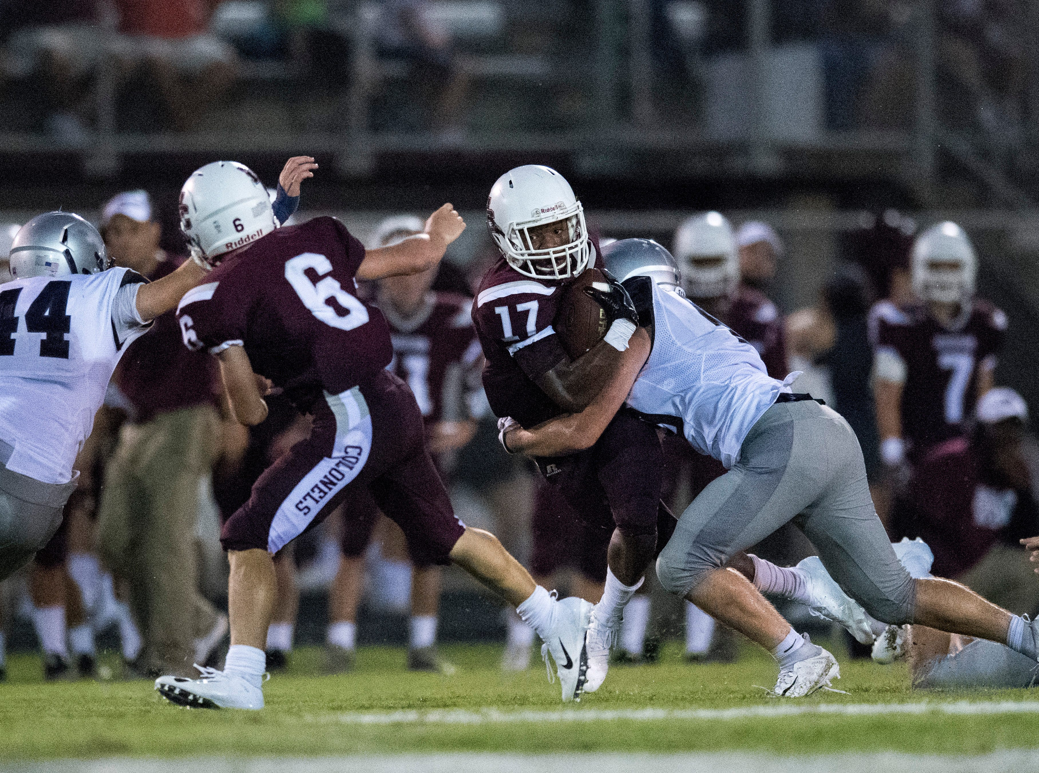 HendersonÕs Isaiah Easley (17) is tackled by Panther defense during the Reitz vs Henderson County game at Colonel Stadium Friday, August 17, 2018. The Panthers defeated the Colonels 41-35 in the season opening game.