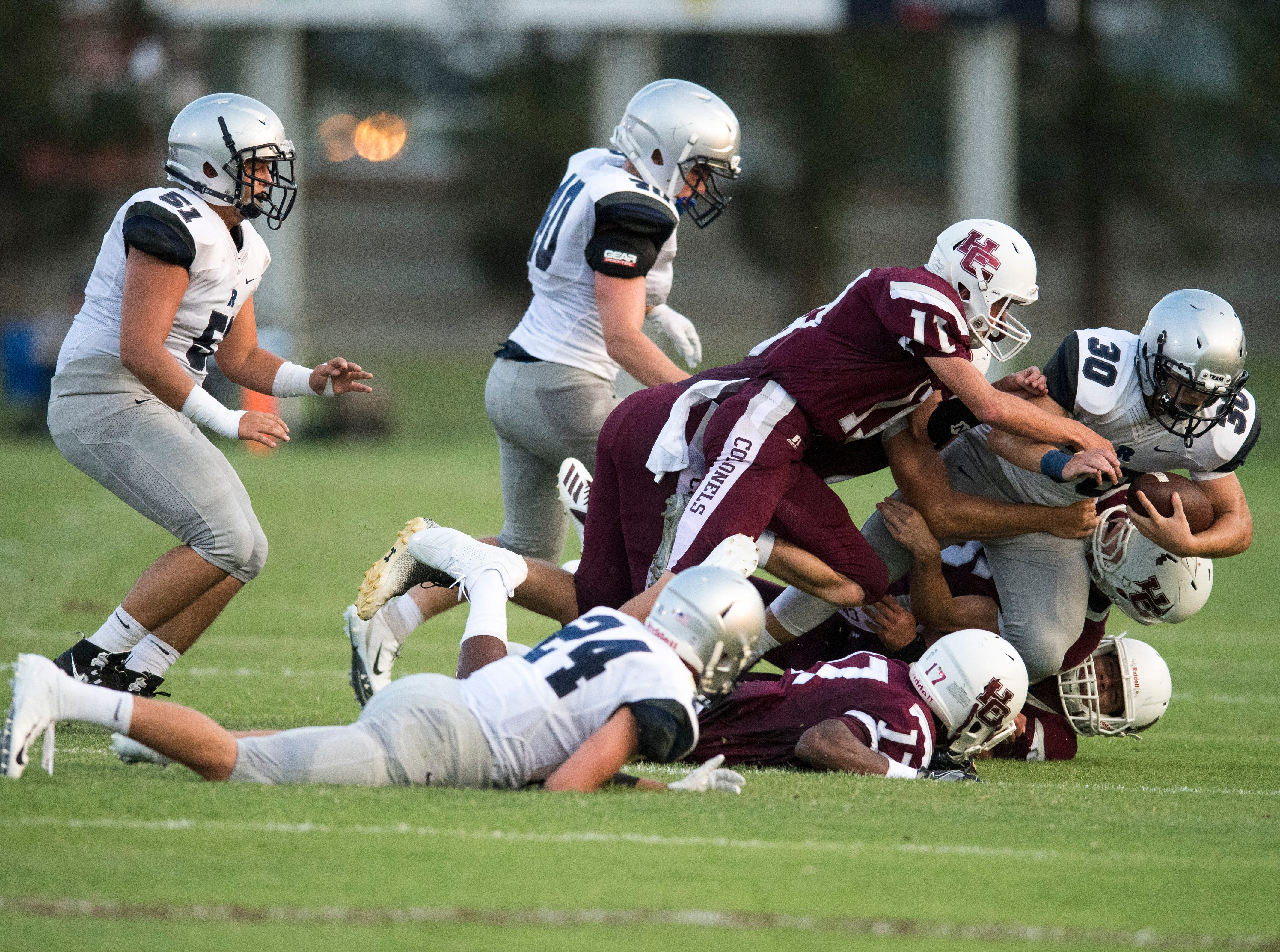 Reitz's Alex Mitchell (30)  is taken down by Henderson Colonels defense during the Reitz vs Henderson County game at Colonel Stadium Friday, August 17, 2018. The Panthers defeated the Colonels 41-35 in the season opening game.