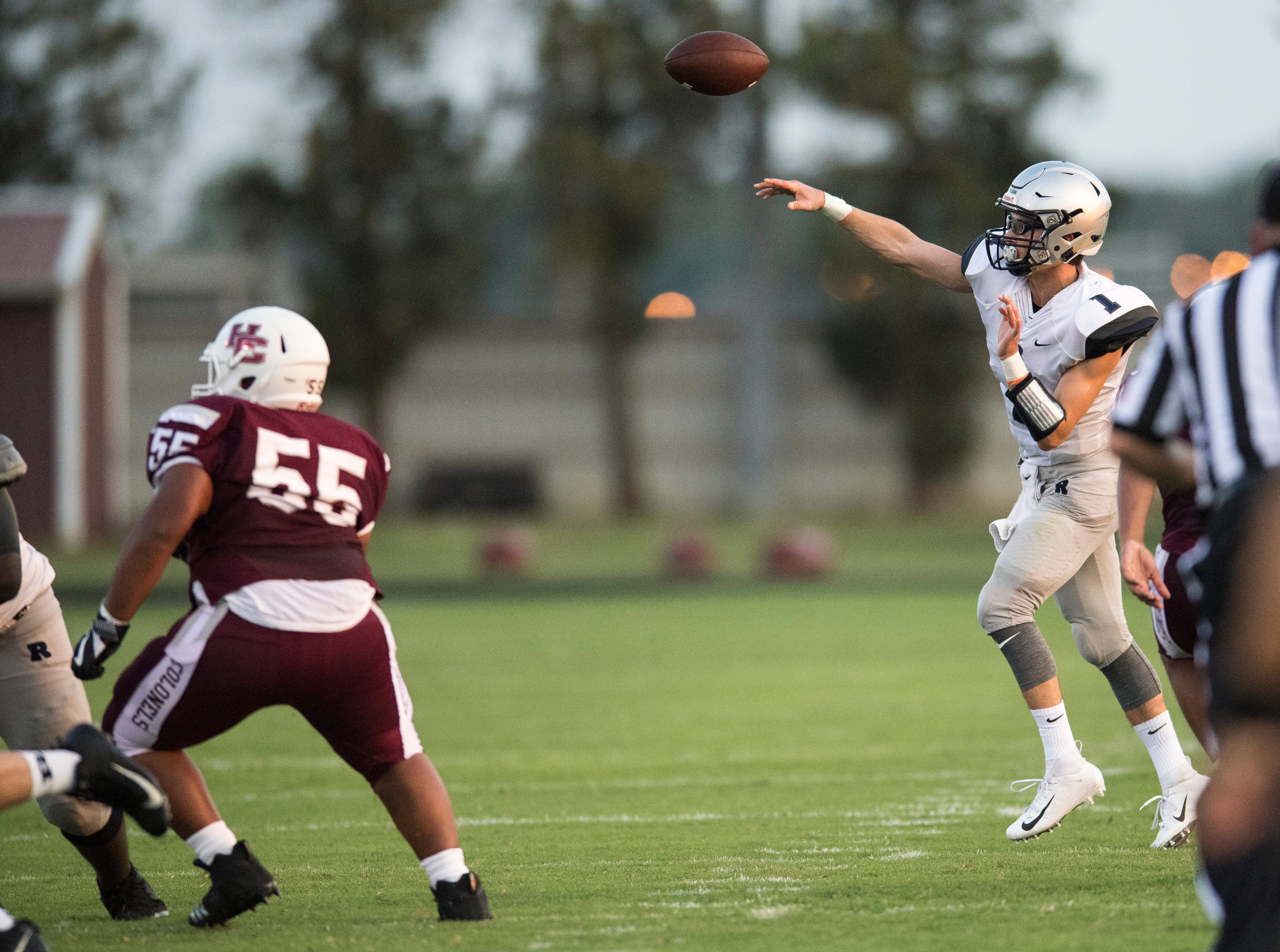 Reitz's Quarterback Eli Wiethop (1)  makes a pass during the Reitz vs Henderson County game at Colonel Stadium Friday, August 17, 2018. The Panthers defeated the Colonels 41-35 in the season opening game.