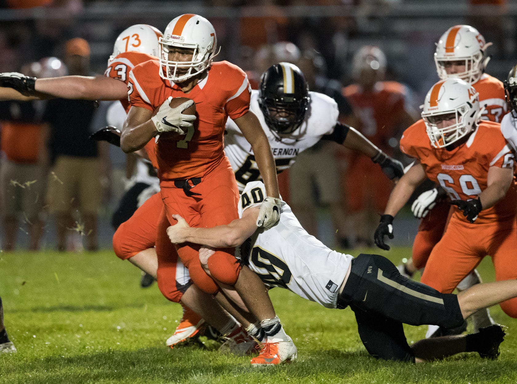 Deshawn King of Hamilton Heights High School is tackled by Cole Schneider from Mount Vernon High School at Hamilton Heights High School football, won by MVHS, 43-14, Arcadia, Friday, Aug. 17, 2018. This game is the first for HHHS head coach Jon Kirschner, who faced his father Mike Kirschner, a veteran and champion coach in his first season at MVHS.