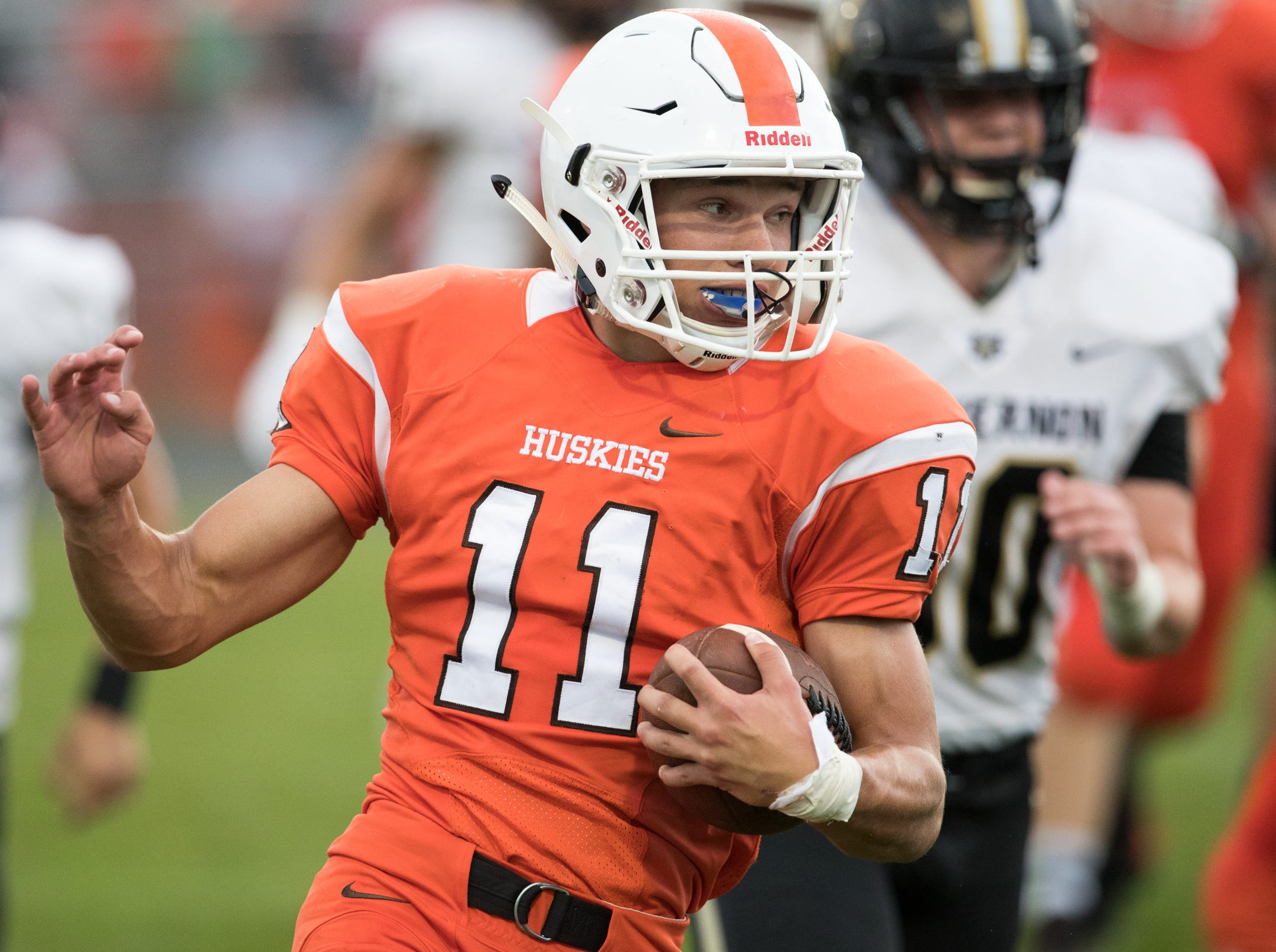 Blake Webel of Hamilton Heights High School, heads upfield on a run against Mount Vernon High School at Hamilton Heights High School football, won by MVHS, 43-14, Arcadia, Friday, Aug. 17, 2018. This game is the first for HHHS head coach Jon Kirschner, who faced his father Mike Kirschner, a veteran and champion coach in his first season at MVHS.