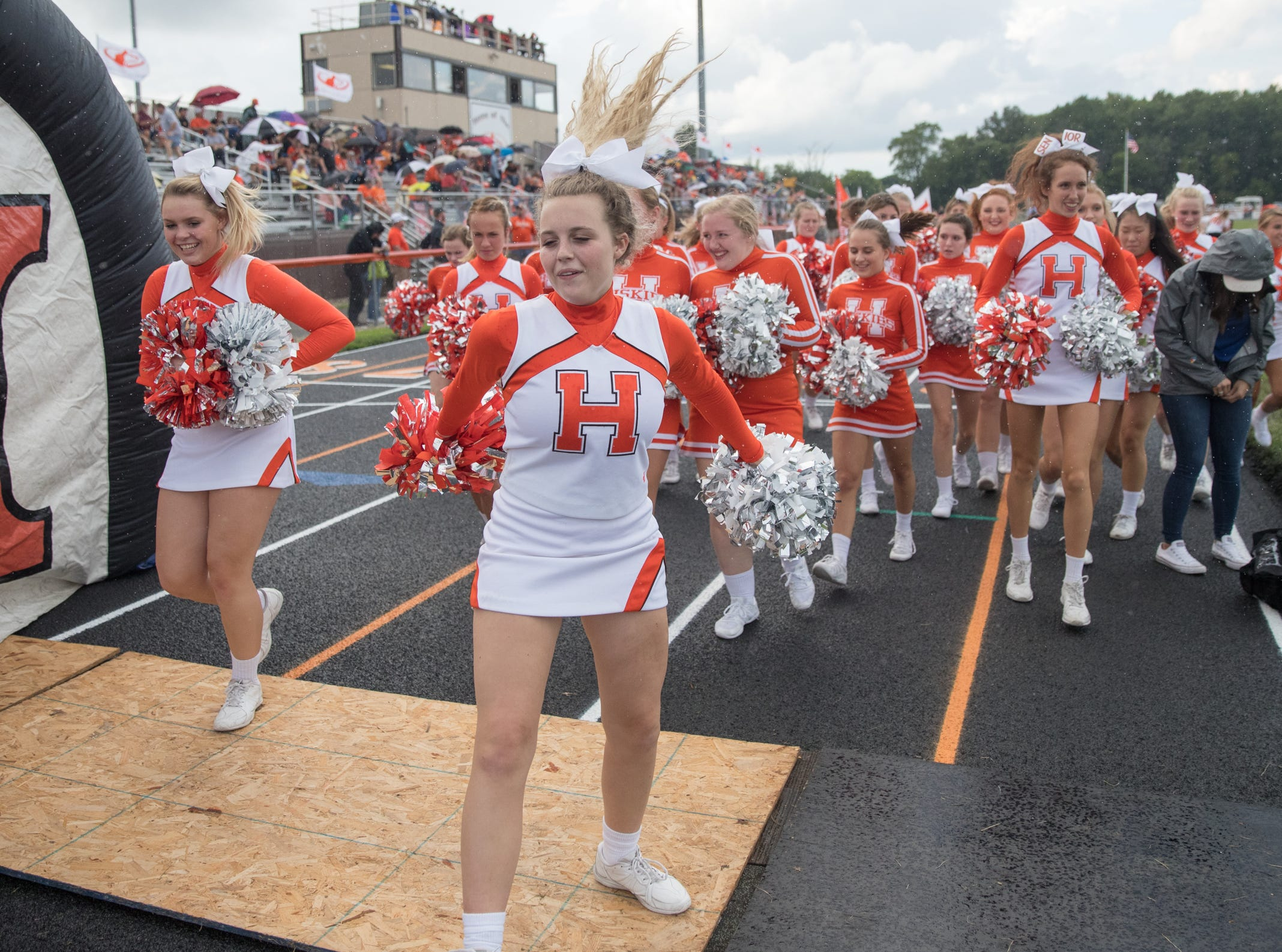Hamilton Heights High School cheerleaders jump into place before game action, Mount Vernon High School at Hamilton Heights High School football, won by MVHS, 43-14, Arcadia, Friday, Aug. 17, 2018. This game is the first for HHHS head coach Jon Kirschner, who faced his father Mike Kirschner, a veteran and champion coach in his first season at MVHS.