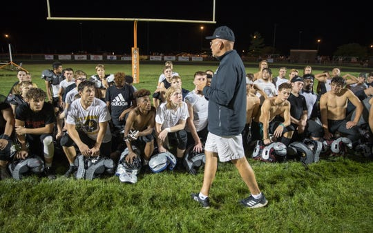 Mike Kirschner, head coach for Mount Vernon High School talks with his players after action at Hamilton Heights High School football, won by MVHS, 43-14, Arcadia, Friday, Aug. 17, 2018. This game is the first for HHHS head coach Jon Kirschner, who faced his father Mike Kirschner, a veteran and champion coach in his first season at MVHS.