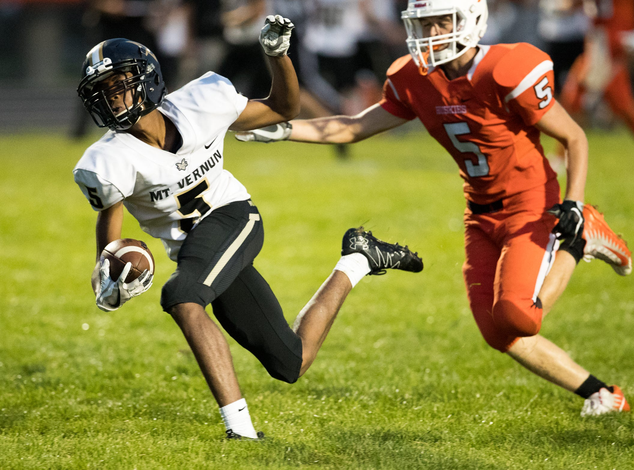 DaRell Jackson of Mount Vernon High School, heads in for a touchdown as he slips defense by Eric Alden of Hamilton Heights High School football, won by MVHS, 43-14, Arcadia, Friday, Aug. 17, 2018. This game is the first for HHHS head coach Jon Kirschner, who faced his father Mike Kirschner, a veteran and champion coach in his first season at MVHS.