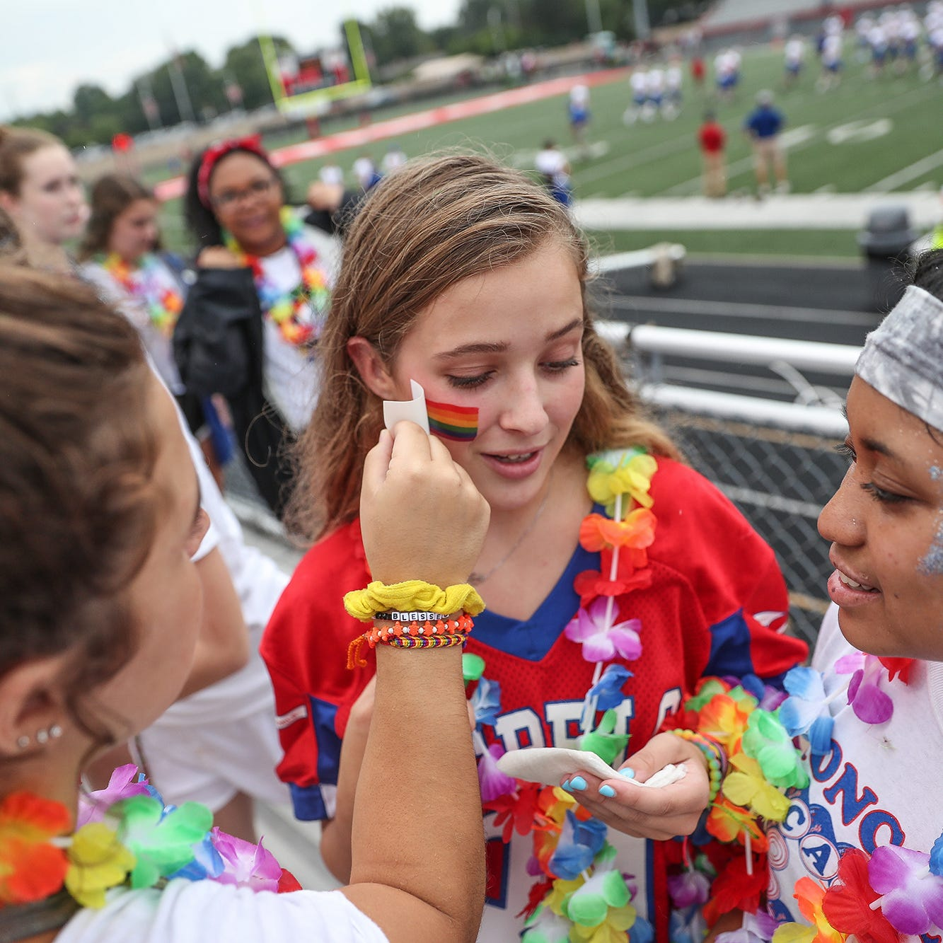 Roncalli, Southport students dot football stadium with rainbows in support of suspended counselor