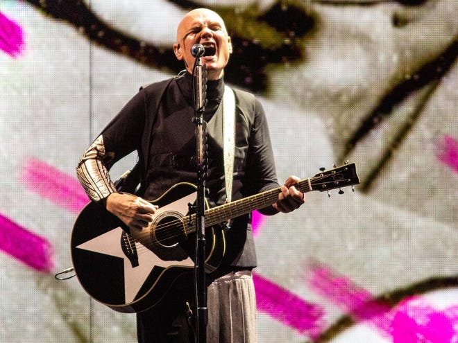 """Billy Corgan sings """"Disarm"""" to open Friday's Smashing Pumpkins show at Bankers Life Fieldhouse."""