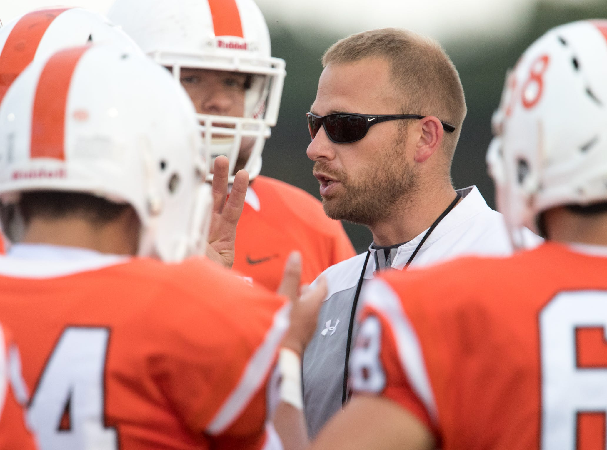 Jon Kirschner, talks with staff and players from Hamilton Heights High School, before game action against Mount Vernon High School, won by MVHS, 43-14, Arcadia, Friday, Aug. 17, 2018. This game is the first for HHHS head coach Jon Kirschner, who faced his father Mike Kirschner, a veteran and champion coach in his first season at MVHS.