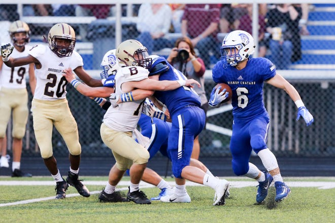 Bishop Chatard Brady Kinnett (6) tries to take advantage of  a block to get some yardage during the first half of  Brebeuf Jesuit vs. Bishop Chatard high school football held at Bishop Chatard High School, Friday, August 17, 2018.