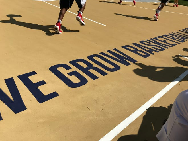 "Among the graphics on the governor's new basketball court is the slogan ""We grow basketball here"" on Saturday, Aug. 18, 2018."