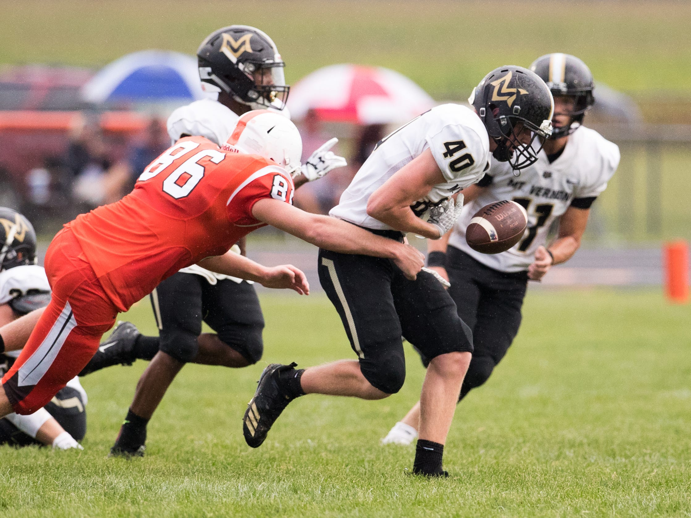 Cole Schneider of Mount Vernon High School, fumbles a ball that was recovered by a teammate, at Hamilton Heights High School football, won by MVHS, 43-14, Arcadia, Friday, Aug. 17, 2018. This game is the first for HHHS head coach Jon Kirschner, who faced his father Mike Kirschner, a veteran and champion coach in his first season at MVHS.
