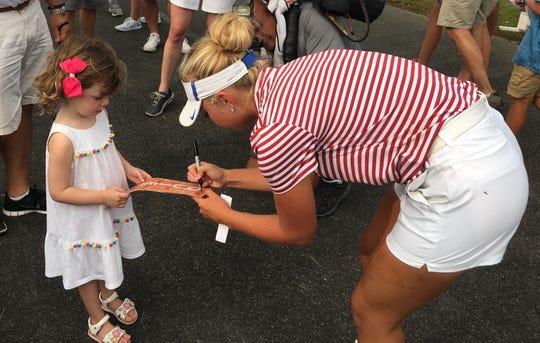 Erica Shepherd with a young fan.