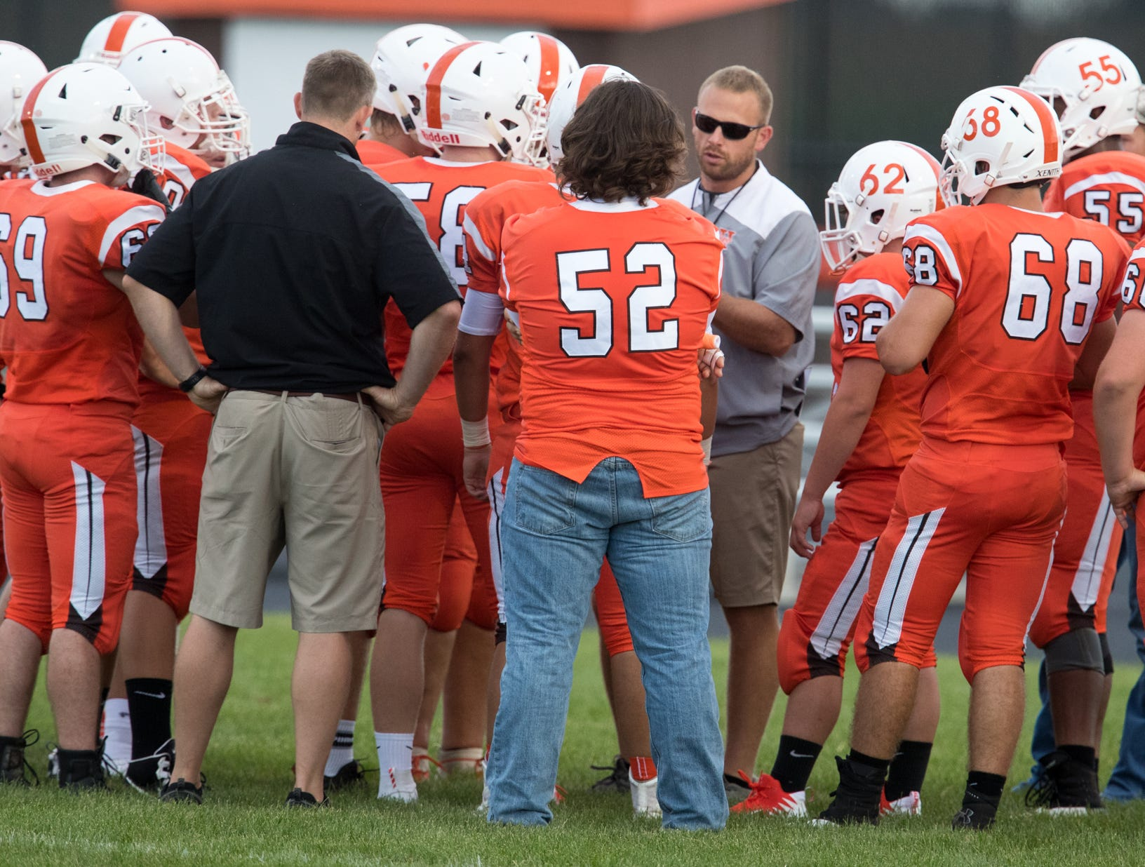 Jon Kirschner (in sunglasses), talks with staff and players from Hamilton Heights High School, before game action against Mount Vernon High School, won by MVHS, 43-14, Arcadia, Friday, Aug. 17, 2018. This game is the first for HHHS head coach Jon Kirschner, who faced his father Mike Kirschner, a veteran and champion coach in his first season at MVHS.