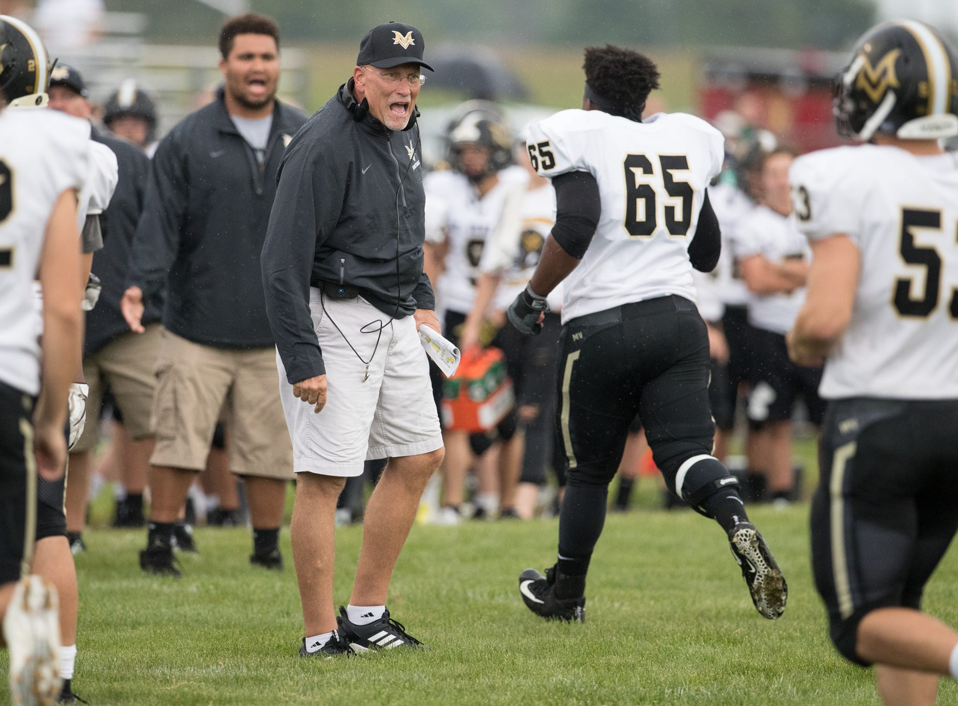 Mike Kirschner, head coach for Mount Vernon High School, congratulates his team on a touchdown at Hamilton Heights High School football, won by MVHS, 43-14, Arcadia, Friday, Aug. 17, 2018. This game is the first for HHHS head coach Jon Kirschner, who faced his father Mike Kirschner, a veteran and champion coach in his first season at MVHS.