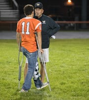 Mike Kirschner, head coach for Mount Vernon High School, chats with injured player Blake Webel from Hamilton Heights High School football, after the game, Arcadia, Friday, Aug. 17, 2018. This game is the first for HHHS head coach Jon Kirschner, who faced his father Mike Kirschner, a veteran and champion coach in his first season at MVHS.