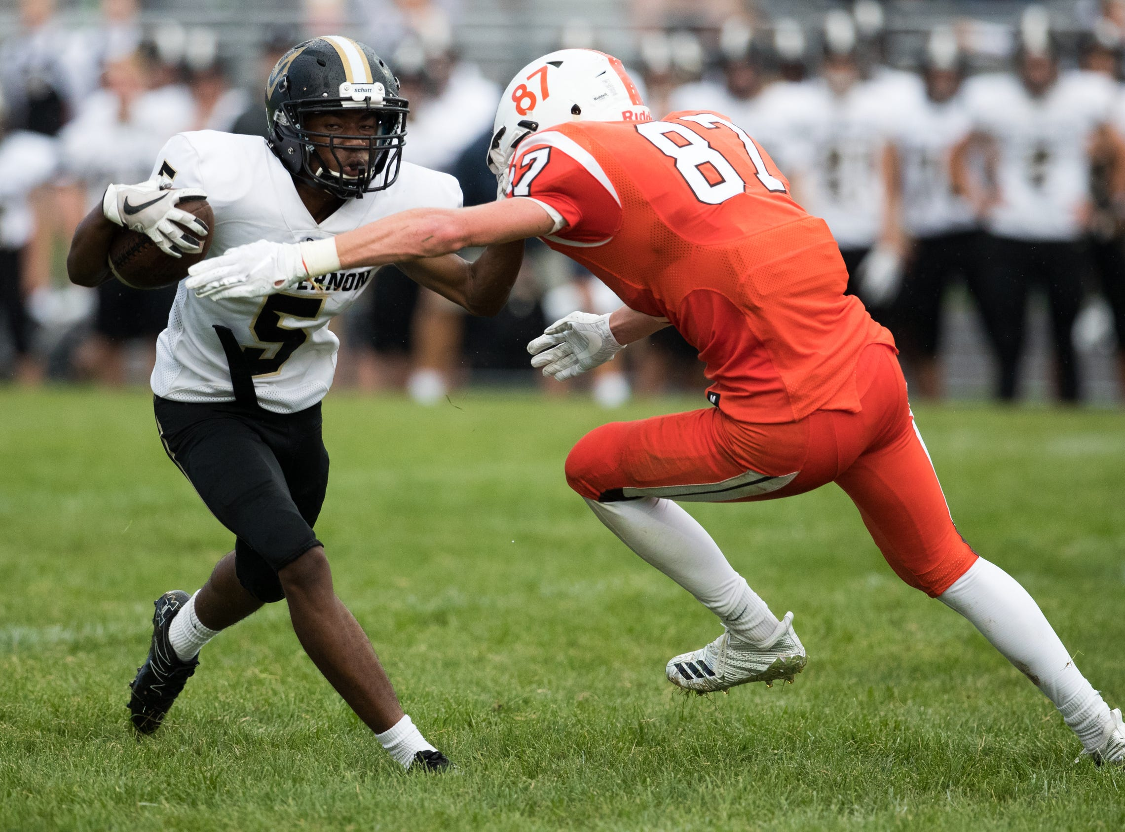 DaRell Jackson (left), of Mount Vernon High School, looks to slip a tackle by Brent Pennington at Hamilton Heights High School football, won by MVHS, 43-14, Arcadia, Friday, Aug. 17, 2018. This game is the first for HHHS head coach Jon Kirschner, who faced his father Mike Kirschner, a veteran and champion coach in his first season at MVHS.