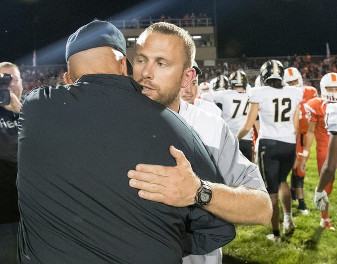 Jon Kirschner (right), hugs his father Mike Kirschner after Mike's squad from Mount Vernon High School won at Hamilton Heights High School football, 43-14, Arcadia, Friday, Aug. 17, 2018. This game is the first for HHHS head coach Jon Kirschner, who faced his father Mike Kirschner, a veteran and champion coach in his first season at MVHS.