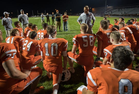 Jon Kirschner, head coach for Hamilton Heights High School, talks with his players after their loss to Mount Vernon High School at Hamilton Heights High School football, Arcadia, Friday, Aug. 17, 2018. This game is the first for HHHS head coach Jon Kirschner, who faced his father Mike Kirschner, a veteran and champion coach in his first season at MVHS.