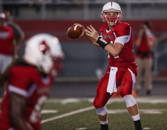 Southport quarterback Eddie Schott (14) throws a pass against Roncalli at Southport High School on Friday, Aug. 17, 2018.